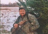 Gerry with his bow in God's Great Outdoors